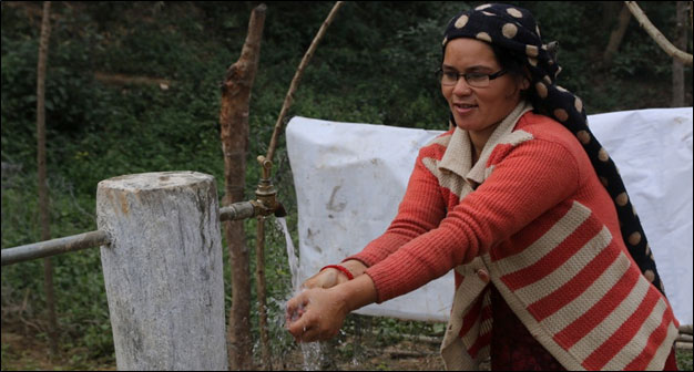 Bidya B.K, Secretary, Laligurans Cooperative; WUG member washes her hands at one of the MUS taps installed in her village of Lekhparajul, Surkhet.